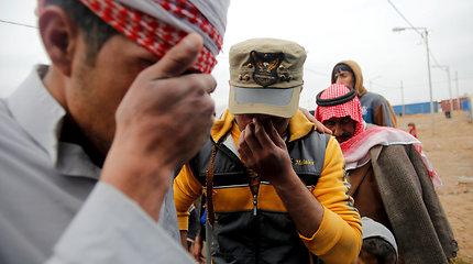 Irakiečiai iš pabėgėlių stovyklų grįžta į sugriautus namus Mosule