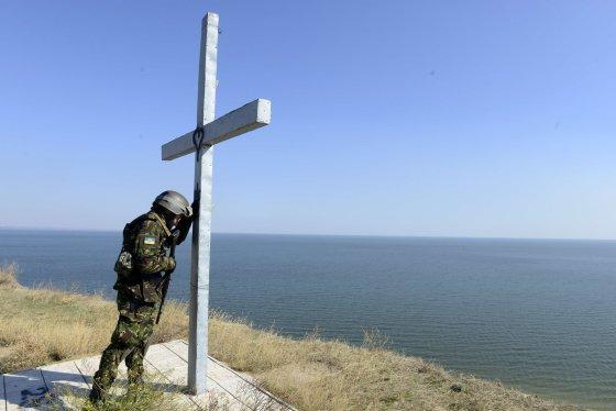 """AFP/""""Scanpix"""" nuotr./Ukrainos karys Mariupolyje"""