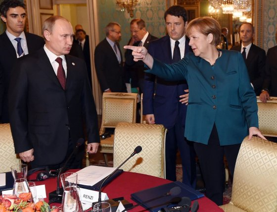 "AFP/""Scanpix"" nuotr./Vladimiras Putinas ir Angela Merkel"