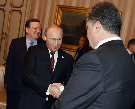 """AFP/""""Scanpix"""" nuotr./Petro Porošenkos ir Vladimiro Putino susitikimas"""