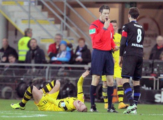 """AFP/""""Scanpix"""" nuotr./Nepaisant Bundeslygos specifikos Marco Reusas niekaip neišsivaduoja iš traumų liūno"""