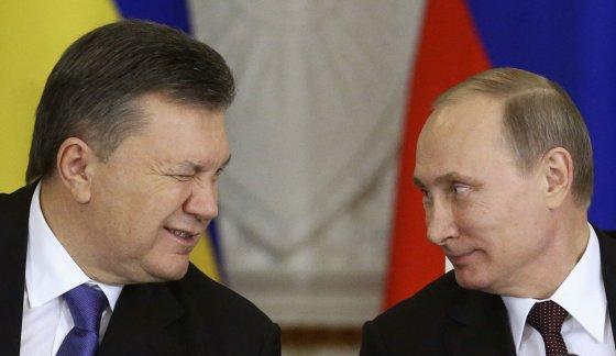 """""""Reuters""""/""""Scanpix"""" nuotr./Ukrainos prezidentas Viktoras Janukovyčius ir Rusijos prezidentas Vladimiras Putinas"""