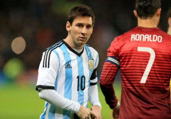 "AFP/""Scanpix"" nuotr./Lionelis Messi ir Cristinano Ronaldo"