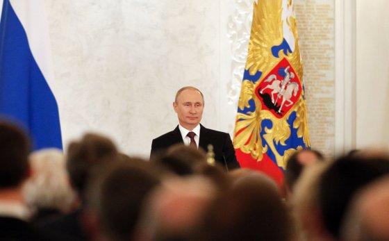 """AFP/""""Scanpix"""" nuotr./Vladimiras Putinas kreipėsi į parlamentą."""