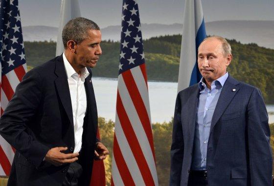 "AFP/""Scanpix"" nuotr./Barackas Obama ir Vladimiras Putinas"