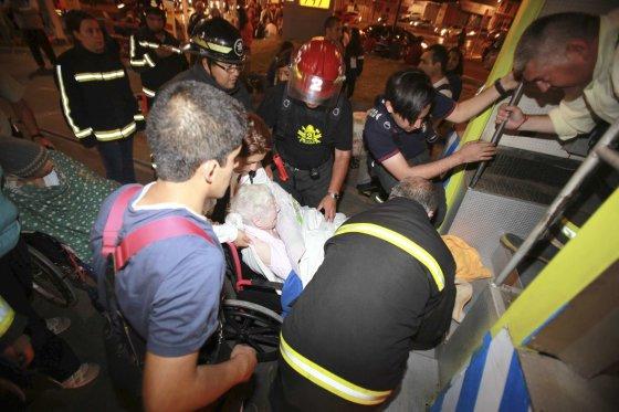"""""""Reuters""""/""""Scanpix"""" nuotr./Čilėjo po žemės drebėjimo evakuoti žmonės"""