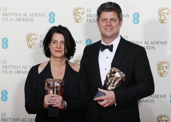 """""""Reuters""""/""""Scanpix"""" nuotr./Anna Pinnock ir Adamas Stockhausenas apdovanoti už geriausią produkcijos dizainą filmui Viešbutis """"Didysis Budapeštas"""""""