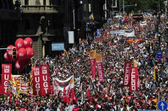 """AP/""""Scanpix"""" nuotr./Gegužės 1-osios protestas Barselonoje"""
