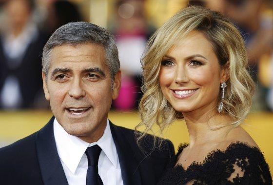"""Reuters""/""Scanpix"" nuotr./George'as Clooney ir Stacy Keibler"