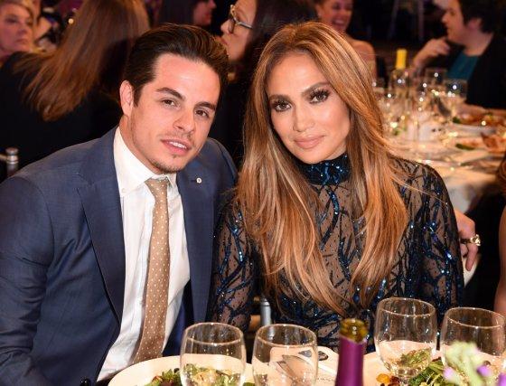 """AFP/""""Scanpix"""" nuotr./Jennifer Lopez ir Casperas Smartas 2014-aisiais"""