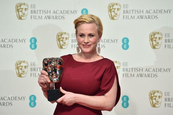 """AFP/""""Scanpix"""" nuotr./Patricia Arquette apdovanota už geriausią antraplanį vaidmenį filme """"Vaikystė"""""""