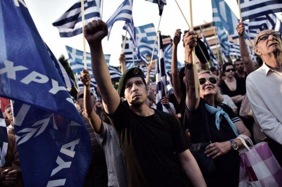 """""""Scanpix"""" nuotr./Auksinės aušros, Graikijos ultranacionalistų partijos, rėmėjai"""
