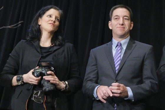 """""""Scanpix"""" nuotr./Laura Poitras ir Glennas Greenwaldas - žmonės, kuriems Edwardas Snowdenas perdavė NSA dokumentus"""