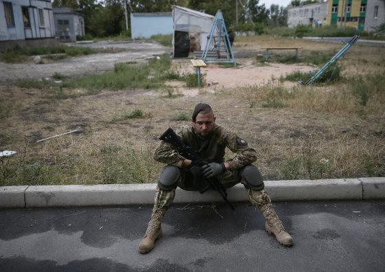"""""""Reuters""""/""""Scanpix"""" nuotr./Ukrainos karys Mariupolyje"""