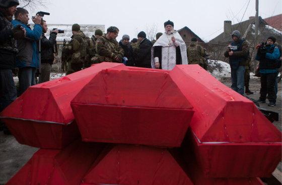 """""""Scanpix""""/ITAR-TASS nuotr./Žuvusių Ukrainos karių karstai"""