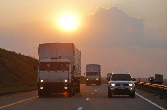 """""""Reuters""""/""""Scanpix"""" nuotr./Rusijos sunkvežimių vilkstinė su humanitarine pagalba"""
