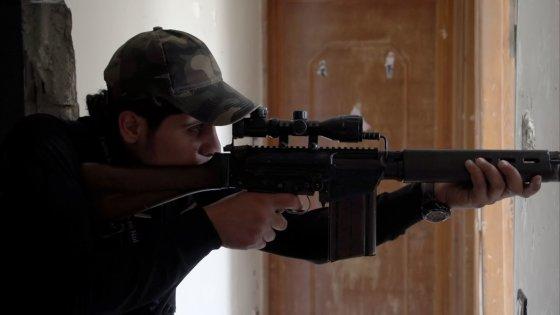 Kadras iš filmo Sugrįžimas į Homsą