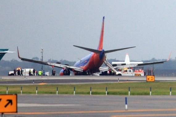 "AFP/""Scanpix"" nuotr./""Boeing 737"" Niujorko oro uoste"