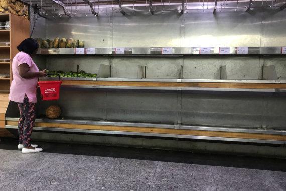 """""""Reuters""""/""""Scanpix"""" nuotr./Pustuštės prekių lentynos Venesueloje"""