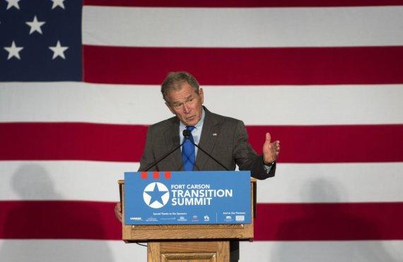 """Scanpix""/AP nuotr./George'as Bushas"