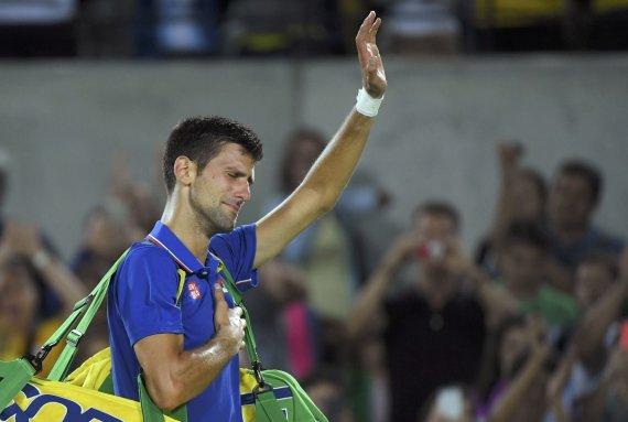 """""""Scanpix"""" nuotr./Novakas Džokovičius Rio olimpiados pirmame etape nusileido Juanui Martinui del Potro"""