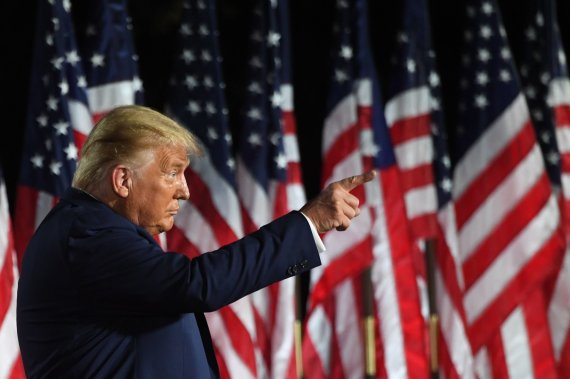 """AFP/""""Scanpix"""" nuotr./Donaldas Trumpas sako kalbą"""