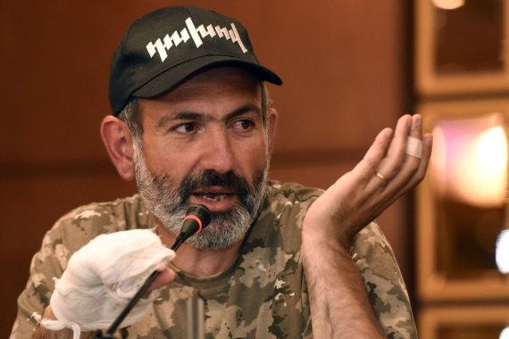 """AFP/""""Scanpix"""" nuotr./Nikolas Pašinianas"""