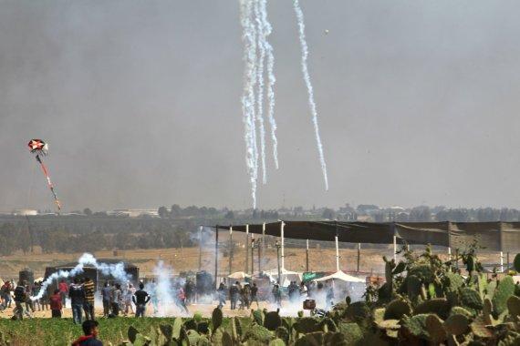 """AFP/""""Scanpix"""" nuotr./Protestuojantys palestiniečiai"""