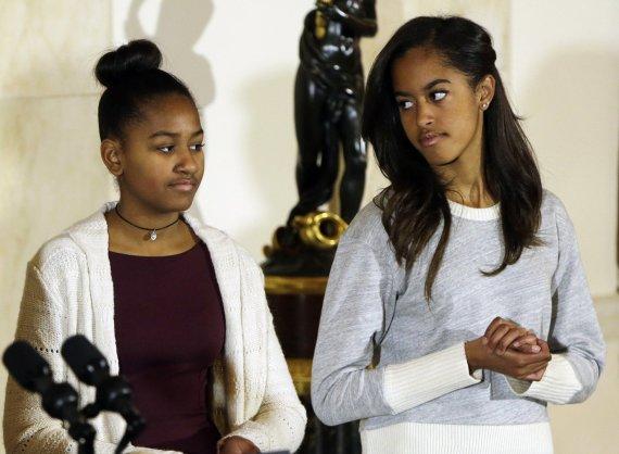 """Reuters""/""Scanpix"" nuotr./JAV prezidento Baracko Obamos dukros Sasha ir Malia"