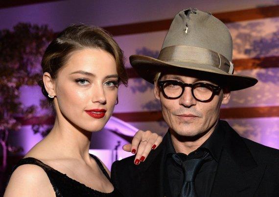 "AFP/""Scanpix"" nuotr./Amber Heard ir Johnny Deppas"