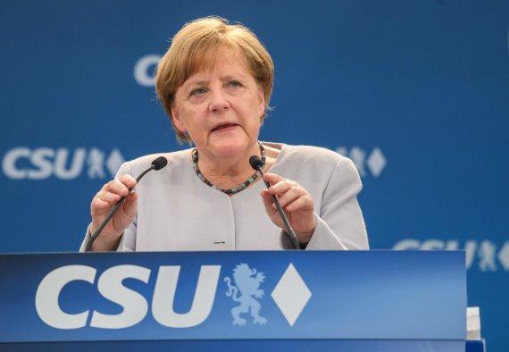"AFP/""Scanpix"" nuotr./Angela Merkel Miunchene"