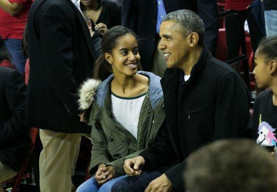 """Scanpix""/""Sipa Press"" nuotr./Barackas Obama su dukra Malia"