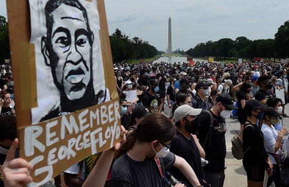 """AFP/""""Scanpix"""" nuotr./Protestas dėl G.Floydo mirties Vašingtone"""