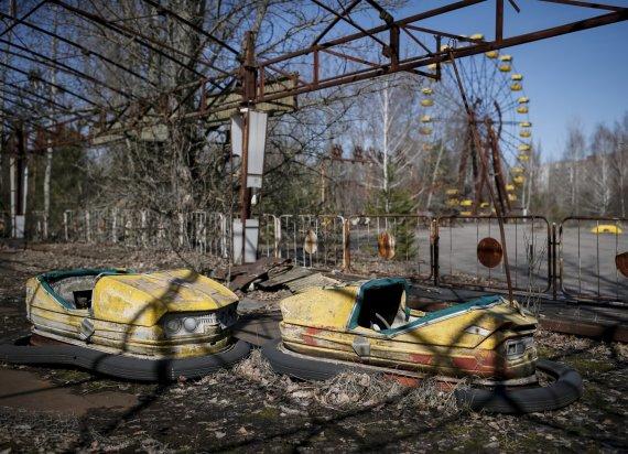 """""""Reuters""""/""""Scanpix"""" nuotr./Praeities šmėklos Černobylio katastrofos vietoje"""