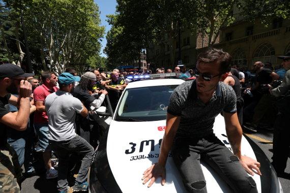 """Reuters""/""Scanpix"" nuotr./Protestai prieš LGBT eitynes Tbilisyje"