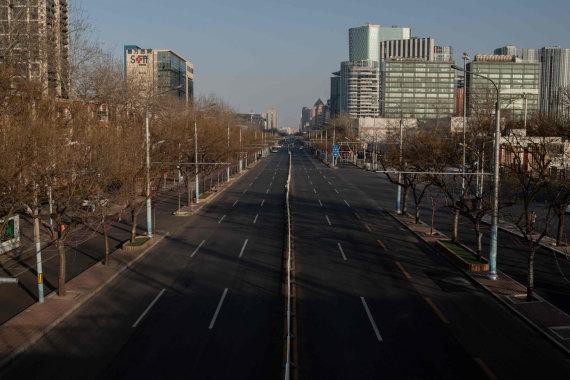 """AFP/""""Scanpix"""" nuotr./Tuščia gatvė Kinijos sostinėje Pekine"""