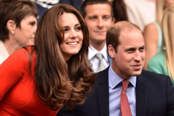 """AFP/""""Scanpix"""" nuotr./Kembridžo hercogiene Catherine ir princas Williamas"""