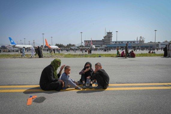 """AFP/""""Scanpix"""" nuotr./Talibanui perėmus Afganistano kontrolę, Kabule tvyro panika"""