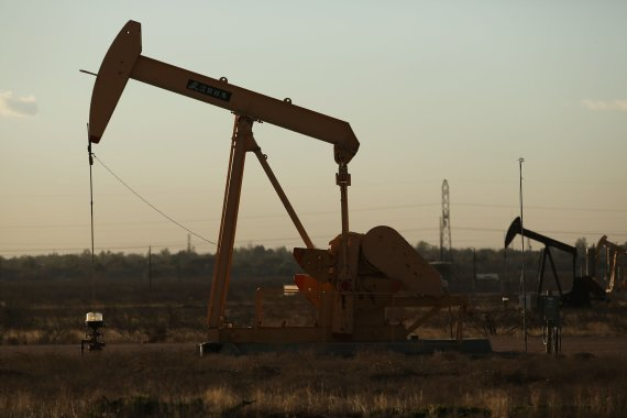 "AFP/""Scanpix"" nuotr./Naftos gavyba"