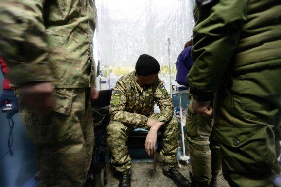 """AFP/""""Scanpix"""" nuotr./Rytų Ukrainoje nesiliaujant susirėmimams Kijevas prašo pagalbos kovoje su Rusija"""