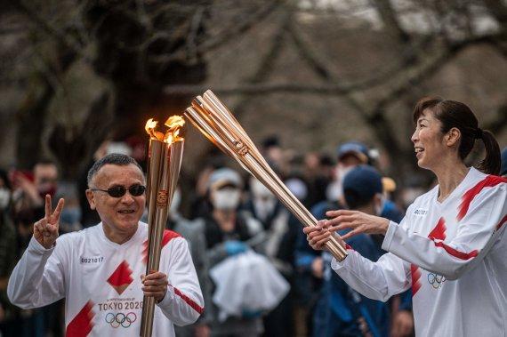 """""""Scanpix"""" nuotr./Atšaukta olimpinio deglo estafetė Osakos gatvėmis"""