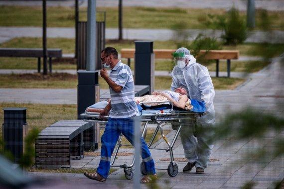 """AFP/""""Scanpix"""" nuotr./Medikai Maskvoje"""