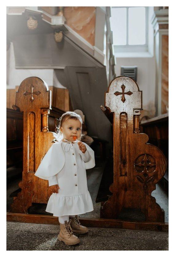 Asmeninio archyvo nuotr./Ovidijaus Petrausko dukros Estelės krikštynų akimirka