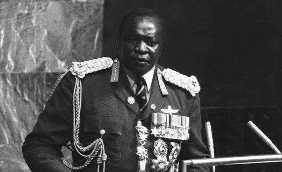 Wikipedia.org nuotr./Idi Aminas Jungtinių Tautų Organizacijos Generalinės Asamblėjos posėdžio tribūnoje 1975 m.
