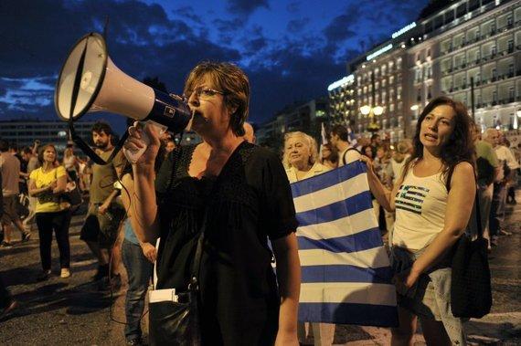 AFP/Scanpix nuotr./Graikai lieja įtūžį ant A.Merkel, kuri esą kalta, kad šalis priversta taupyti iki begalybės
