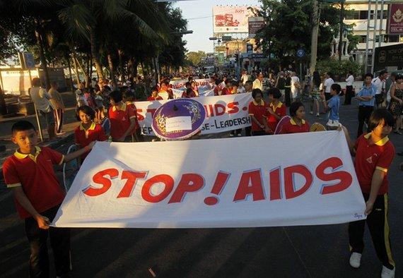 """""""Reuters""""/""""Scanpix"""" nuotr./Pasaulinės kovos su AIDS dienos minėjimas"""
