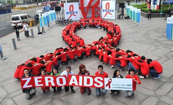 """AFP/""""Scanpix"""" nuotr./Pasaulinės kovos su AIDS dienos minėjimas"""