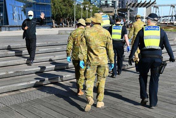 """AFP/""""Scanpix"""" nuotr./Koronavirusas Melburne"""