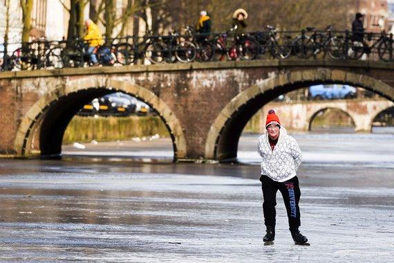 "AFP/""Scanpix"" nuotr./Žiema Amsterdame"