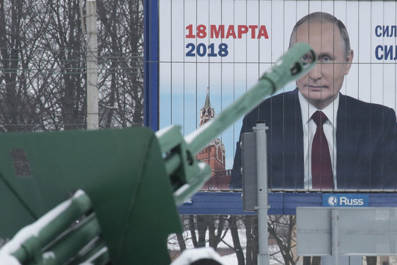 """""""Reuters""""/""""Scanpix"""" nuotr./Vladimiro Putino rinkiminis plakatas"""